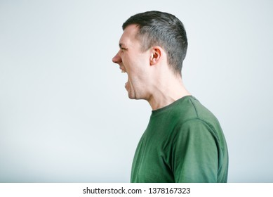 portrait of a man shouting angry, studio photo over background