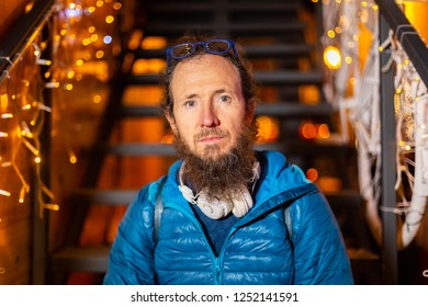 Portrait of man sitting on stairs at Christmas market, Zagreb, Croatia.