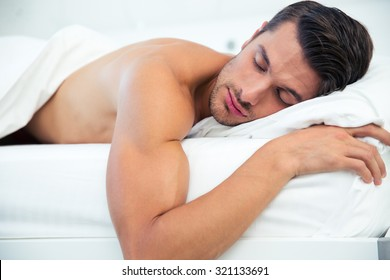 Portrait of a man sleeping in the bed at home