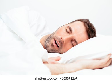 Portrait of a man sleeping with an open mouth