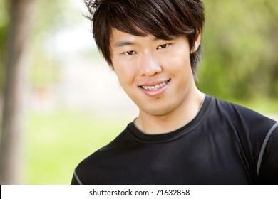 Portrait of a man smiling against blur background