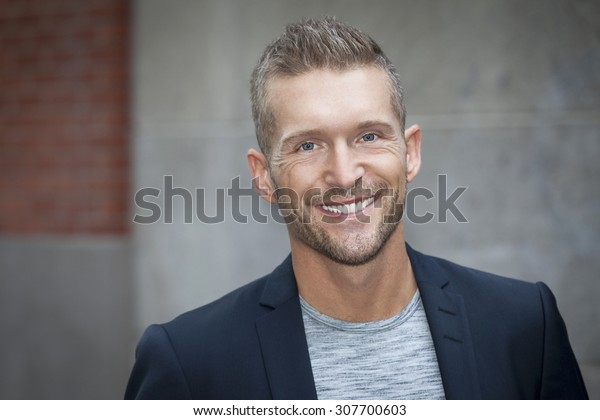 Portrait Of A Man Smiling At The Camera
