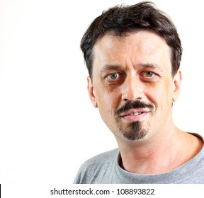 Portrait of a man smiling, isolated on white background