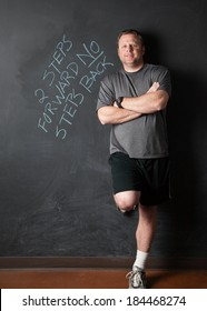 Portrait of Man, in Successful Weight Loss Program, Standing Next to Motivational Quote.