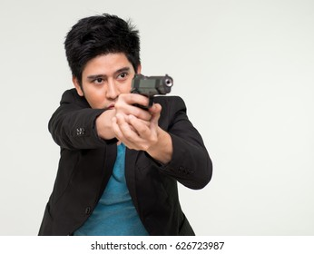 Portrait of a man in suit holding gun against a grunge background,Image of a confident handsome policeman holding a handgun, Businessman takes to gun to protect his business,Age 20-30 yeas