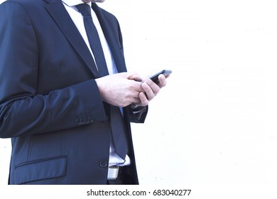Portrait of man with suit using cellphone
