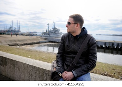 Portrait of   man in sunglasses on ship background in the early spring