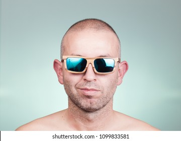 Portrait of a man with sunglasses in a studio shot