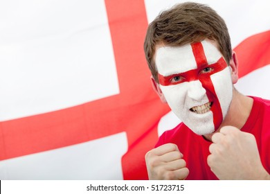 Portrait of a man supporting his team with the english flag painted on his face