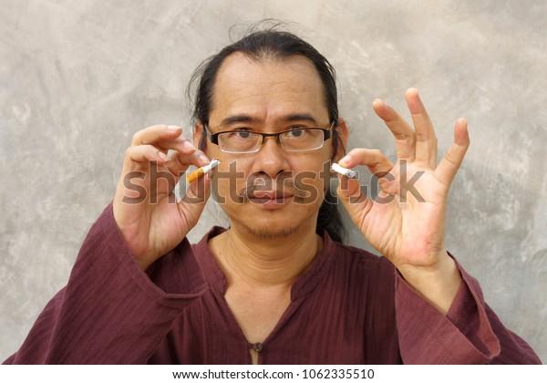portrait of man with tear cigarette