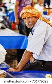Portrait of a man that is selling vegetables at the turkish bazaar in Seferihisar (Izmir - Turkey). Seferihisar (Izmir, Turkey); 29 august 2017