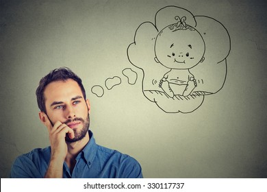Portrait man thinking dreaming of a child