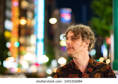 Portrait of a man traveling in Japan and enjoying the nightlife in Shinjuku in Toyko.