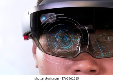 Portrait of man try Mixed reality with HoloLens glasses isolated on white background.