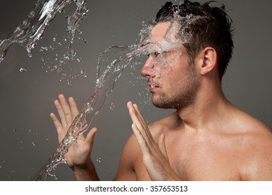 portrait of a man under the water jets