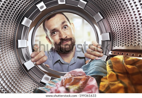 portrait of man view from washing machine inside