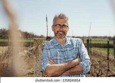 portrait of man in vineyard