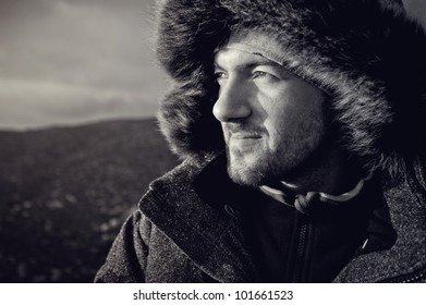 portrait of a man in warm clothes traveler in the extreme, cold conditions in the expedition