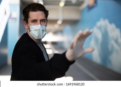 Portrait of a man wearing a breathing mask and rubber gloves at the time of the corona virus