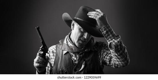 Portrait of man wearing cowboy hat, gun. Portrait of a cowboy. West, guns. Portrait of a cowboy. American bandit in mask, western man with hat. Portrait of farmer or cowboy in hat. American farmer.