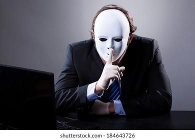 Portrait of man wearing elegant suit in white mask