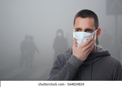 Portrait of man wearing facial hygienic mask outdoors. Ecology, air pollution, Environmental awareness and virus protection concept