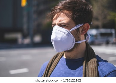 Portrait of man wearing homemade face mask outdoors during global COVID-19 coronavirus pandemic.  Person in New York City wearing mask.