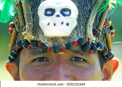 Portrait of a man wearing traditional Peruvian clothing and dancing Anaconda dance, a musical genre typical of Amazon region of Peru