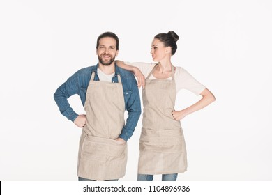 portrait of man and woman in aprons isolated on white