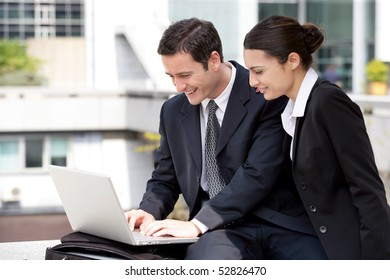 Portrait of a man and a woman with a laptop computer