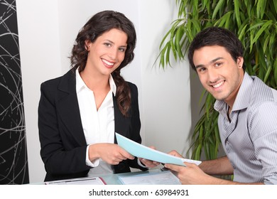 Portrait of a man and a woman in a meeting