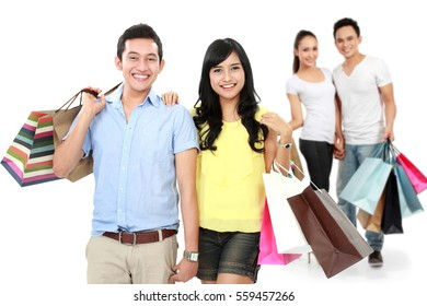 portrait of man and woman with shopping bag smiling to camera