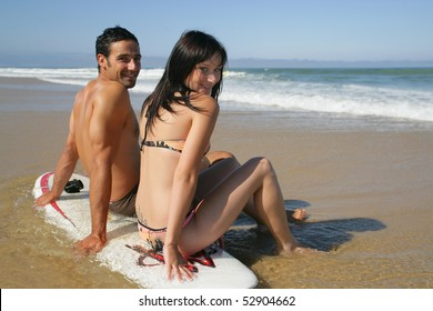 Portrait of a man and a woman wearing a swimsuit