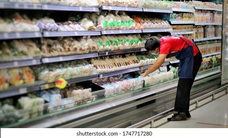 Portrait of a man is worker or staff dairy stocking or checking food products at supermarket or store