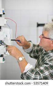 Portrait of a man working on a circuit breaker