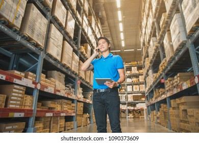 Portrait Of Manager In Warehouse. wholesale, logistic, people and export concept . Business owner Using Tablet Computer In Distribution Warehouse.