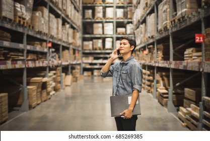 Portrait Of Manager In Warehouse. wholesale, logistic, people and export concept .