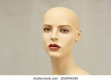 Portrait of a mannequin on a gray background