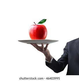 Portrait of a man's hand carrying a red apple on a dish