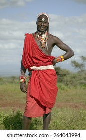 Portrait of Masai Warrior in traditional red toga at Lewa Wildlife Conservancy in North Kenya, Africa