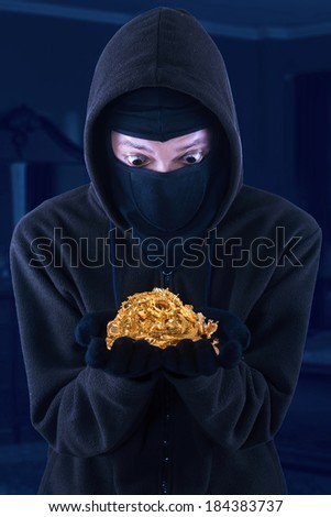 Portrait Masked Man Holding Stolen Gold Stock Photo (Edit