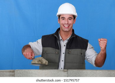 Portrait of a mason busy constructing a wall