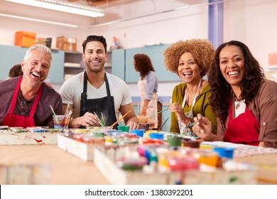 Portrait Of Mature Adults Attending Art Class In Community Centre