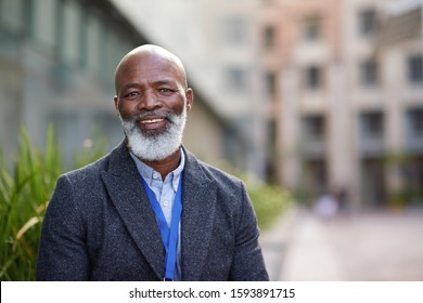 Portrait mature african american businessman smiling happy in city