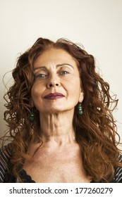 Portrait of mature attractive woman against white background