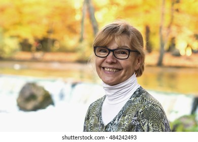 Portrait of mature attractive woman with blond hair outdoor