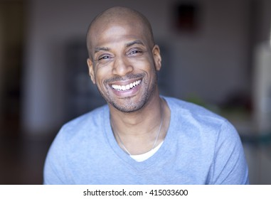 Portrait Of A Mature Black Man Smiling At Home