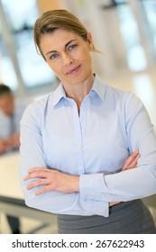 Portrait of mature blond businesswoman