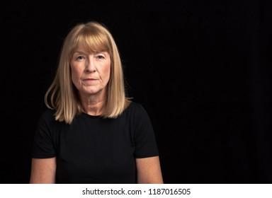 Portrait of a mature blonde female 50-59 facing camera.