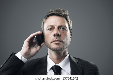 Portrait of a mature business man talking on phone